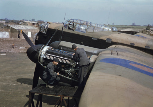 Mechanics work on the port engines of an Avro Lancaster