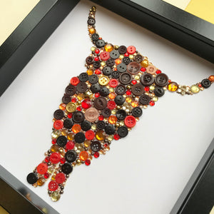 gold and bronze highland cow button art on white. framed picture