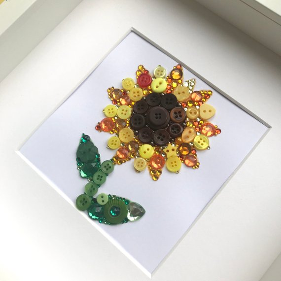 Sparkly yellow sunflower. Framed button art.
