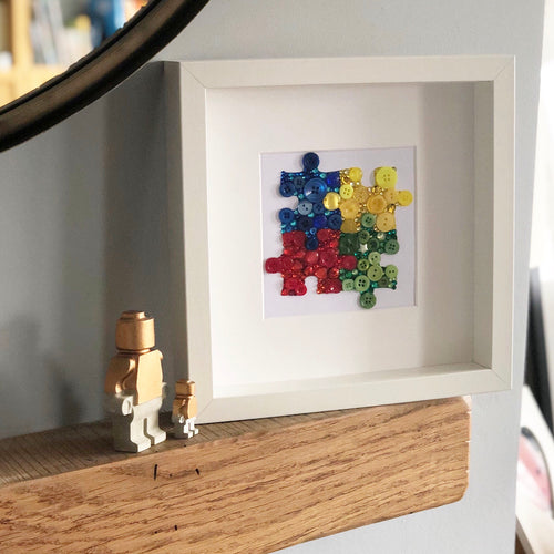 Autism awareness puzzle pieces framed button art