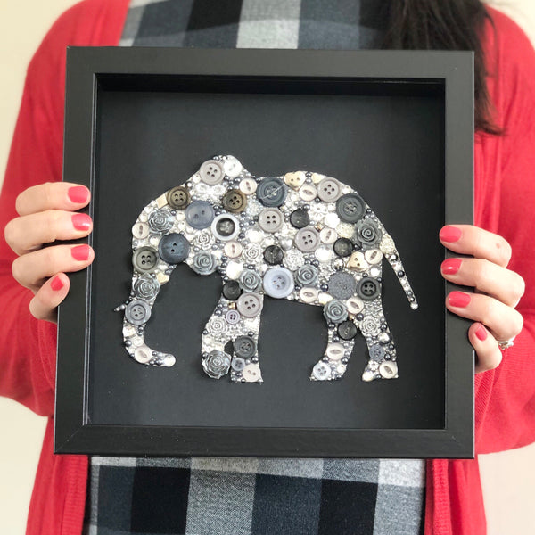 Button art elephant on black. Ivory anniversary framed picture.