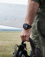 Bremont BOB Spitfire watch on fighter pilots wrist with the iconic aircraft pictured in the background