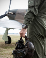 Bremont BOB Hurricane watch on figheter pilots wrist with the iconic aircraft pictured in the background