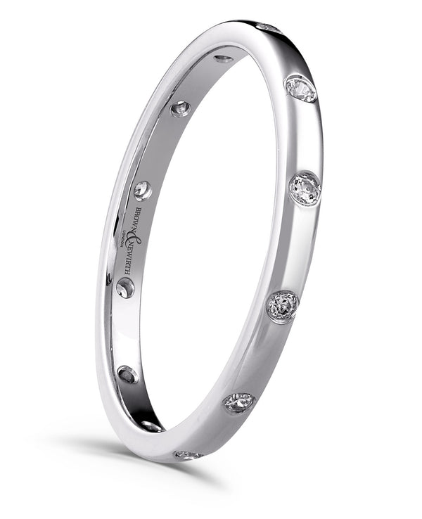 Ladies Altair wedding ring from Brown & Newirth. A polished band graced by 12 equally spaced round diamonds.