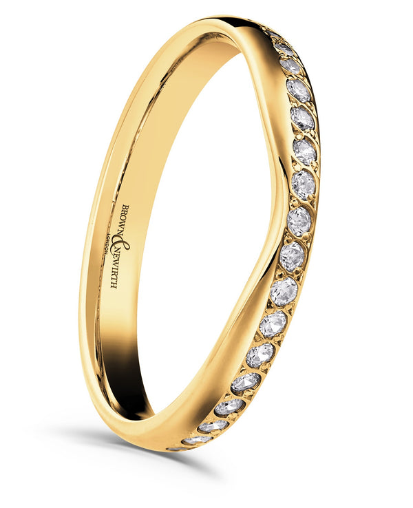 Ladies Capella wedding ring from Brown & Newirth. Dipped band, graced by a offset row of nineteen round brilliant cut diamonds.
