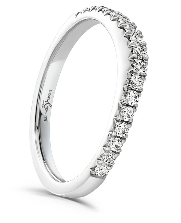 Curve ladies wedding ring from Brown & Newirth. 17 hand set diamonds on a curved band.