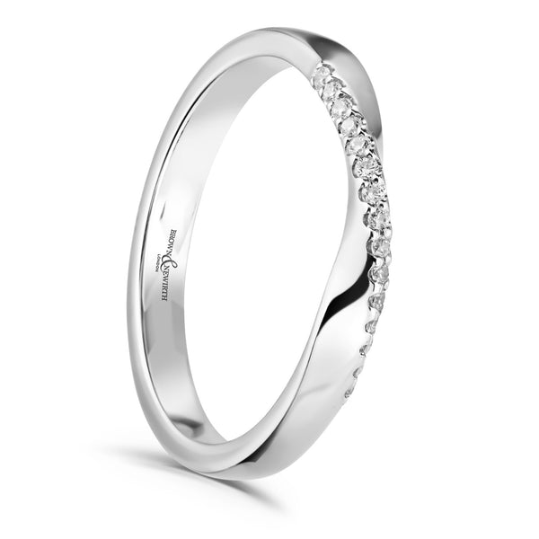 Diamond set ladies Daria wedding ring from Brown & Newirth. Delicate twisted, diamond set band with a total of fifteen round brilliant cut diamonds. B&N style code XD1160
