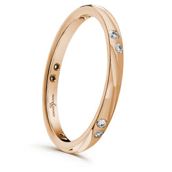2mm wide ladies Dewdrop wedding ring from Brown & Newirth. Sweeping patterned band with five pairs of round brilliant cut diamonds totalling 0.11 carats. B&N style code XD300