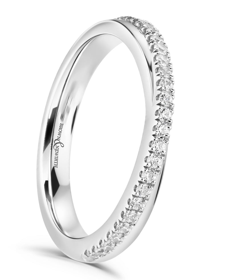 The ladies Elsa wedding ring from Brown & Newirth offers a feminine cross over band, graced by twenty six round brilliant cut diamonds totalling a cart weight of 0.18ct.