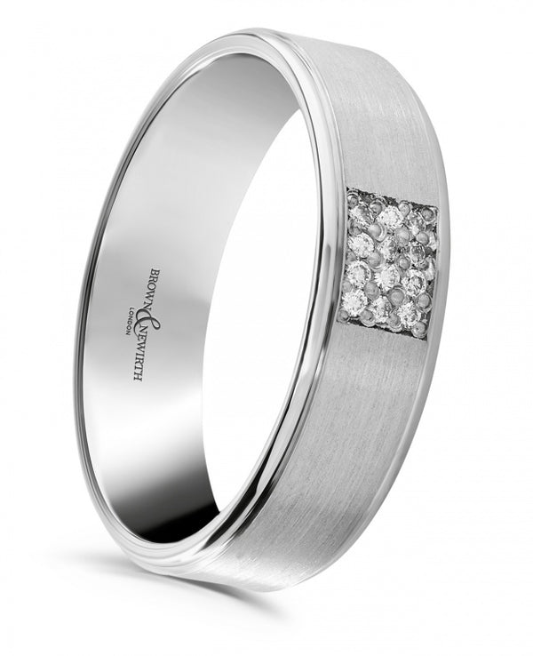 Mens Eridanus wedding ring from Brown & Newirth offers a modern, medium weighted flat top court profile with twelve pave set, round brilliant cut diamonds totalling 0.08 carats