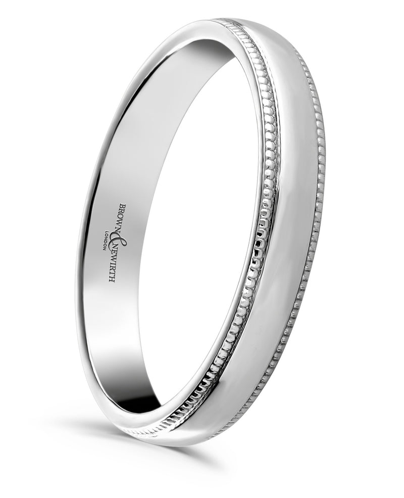 Ladies Grain wedding ring from Brown & Newirth. The fine millgrain edges add a contemporary twist on a timeless style. B&N style code ANMG