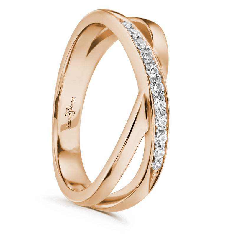 Cross over split band with diamonds on a rose coloured band