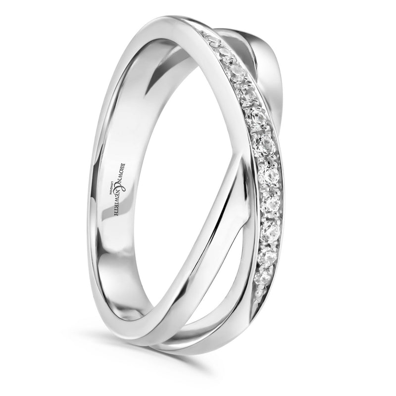 Cross over split band with diamonds on a silver coloured band