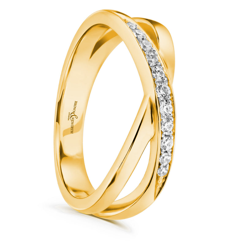 Cross over split band with diamonds on a gold coloured band