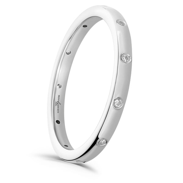 Ladies Lyra wedding ring from Brown & Newirth. A simplistic 2mm band design set with eleven equally spaced round brilliant cut diamonds.