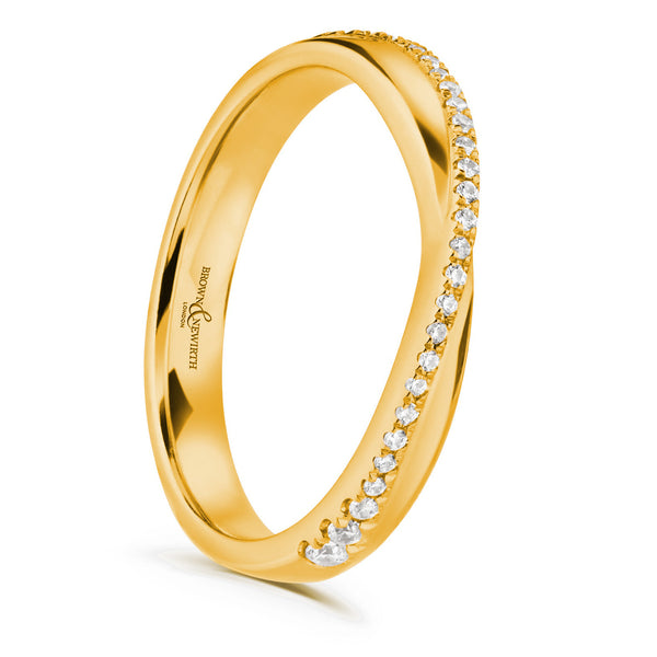 Ladies Tinkerbelle wedding ring from Brown & Newirth. Cross over band with a row of diamonds.