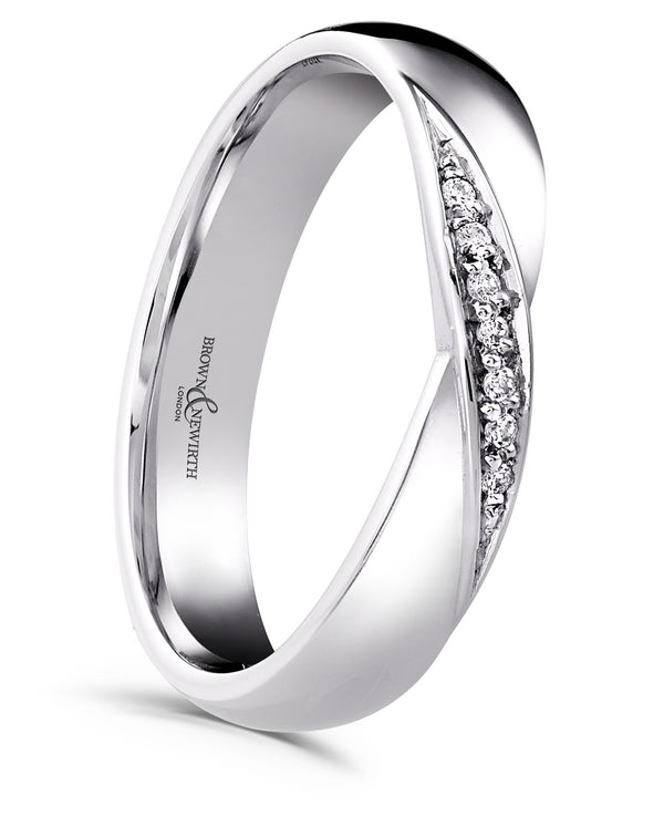 Ladies Vega wedding ring from Brown & Newirth with a luxury gauge classic court profile with a feminine cross over band, graced by seven round brilliant cut diamonds totaling 0.35 carats. B&N style code XD747