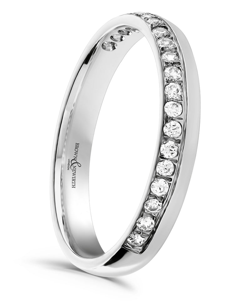 Ladies 3mm Venus wedding ring from Brown & Newirth offers a timeless light court profile that is graced by twenty offset round brilliant cut diamonds totaling 0.22 carats. B&N style code HET543
