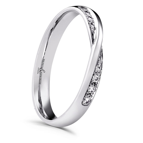 Cross over diamonds in a silver coloured band