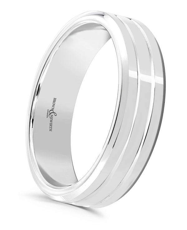Mens Artemis wedding ring from Brown and Newirth. Medium weighted with a flat outside and rounded inside. Polished finish with two striking lines. ANFP546