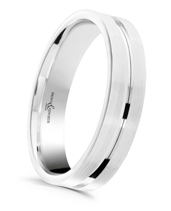 Mens wedding ring from Brown and Newirth. Medium weighted with a flat outside and rounded inside. Sanded finish with polished Palladium 950 central ring.