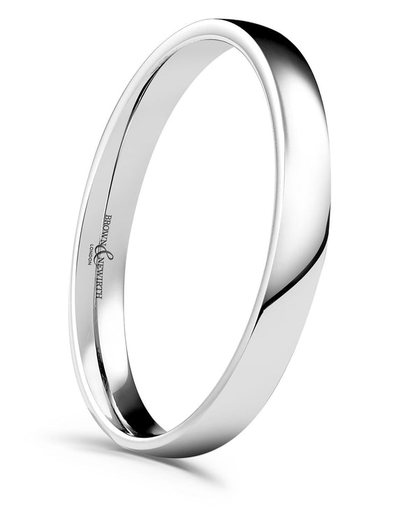 Ladies low domed court style wedding ring from Brown and Newirth. Light weighted with a slightly curved outside and rounded inside. Smooth, polished finish. LZN