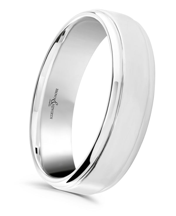 Mens Gravity wedding ring from Brown and Newirth. Medium weighted with a flat outside and rounded inside. Polished finish with two rolled edges.