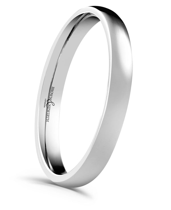 Ladies Simplicity medium gauge court style wedding ring from Brown and Newirth. Light weighted with a curved inside and outside. Smooth, polished finish. Style reference: XN