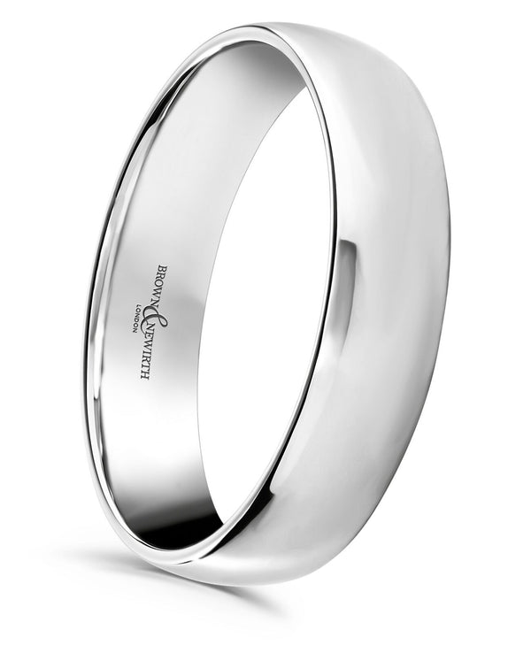 Mens lightweight court style wedding ring from Brown and Newirth. Light weighted with a curved inside and outside. Smooth, polished finish. LWC