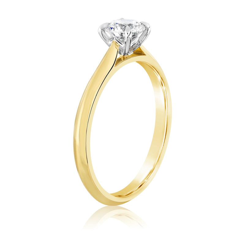 Yellow gold ring with large diamond with white gold setting on show
