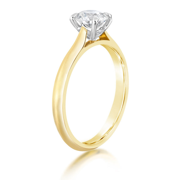 Yellow gold ring with large diamond with platinum setting on show