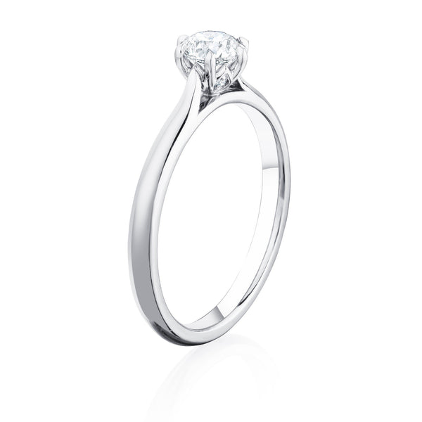 Platinum ring with 0.50 carat round diamond in six claw setting angled view