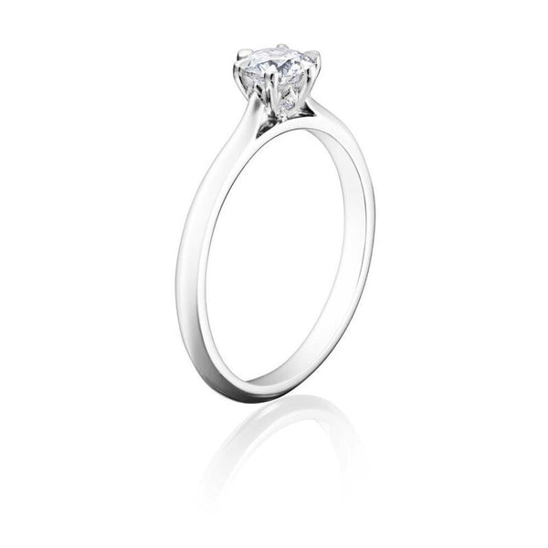Burrells Winchester Collection Platinum 0.50 carat round diamond solitaire ring in six claw setting. Angled View b