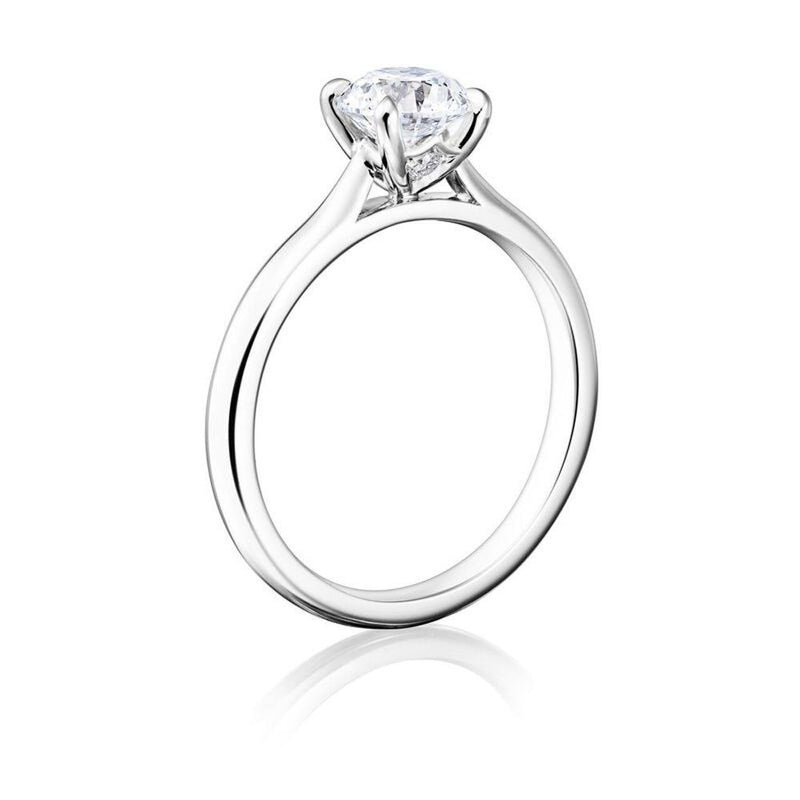 Burrells Winchester Collection Platinum 1 carat round diamond solitaire ring in four claw setting. Angled View