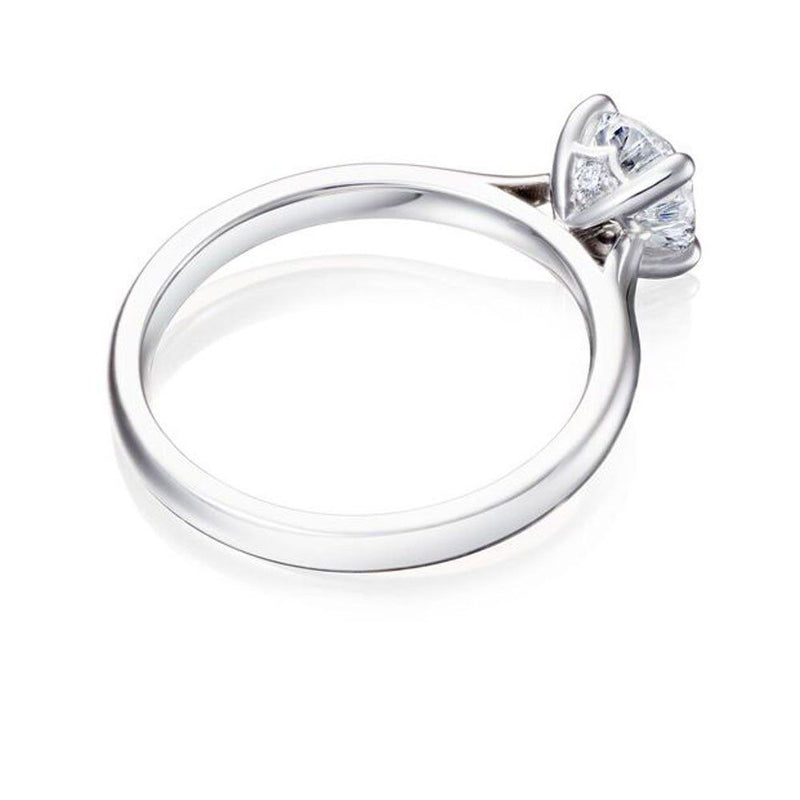 Burrells Winchester Collection Platinum 1 carat round diamond solitaire ring in four claw setting. Laying flat View