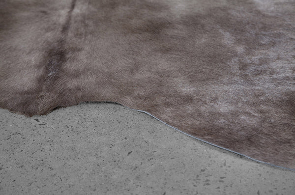 crown and birch grey cowhide rug angle