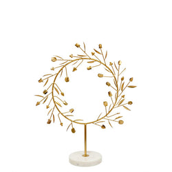 crown and birch athena wreath on stand front