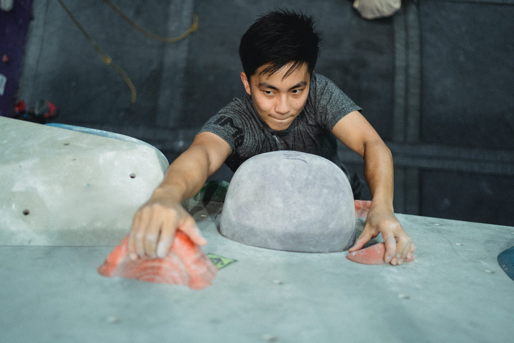 Climber Reaching For Hold Indoor Bouldering