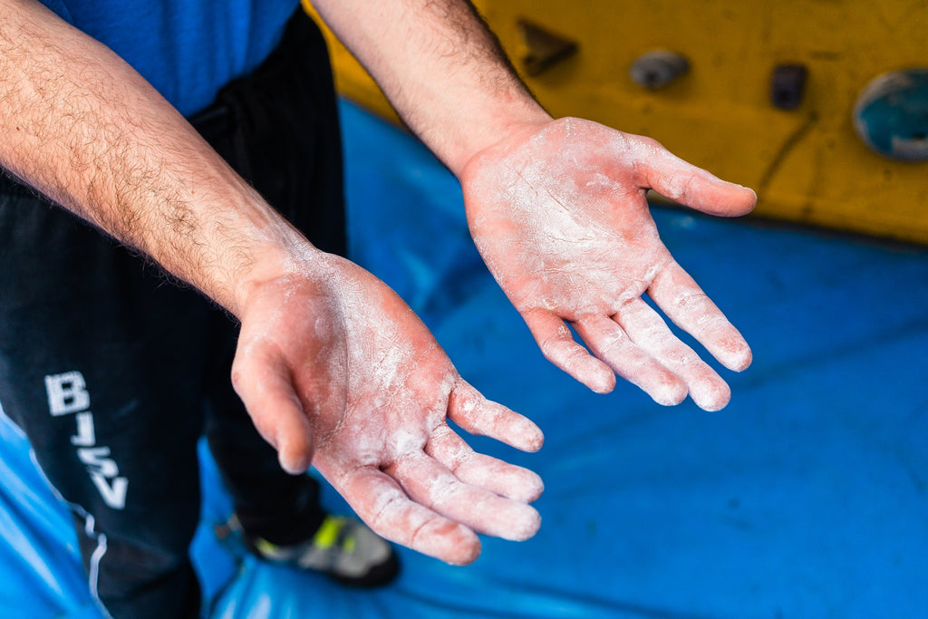 Climber with chalk on hands