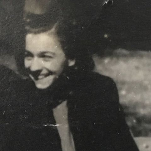 Ola Bjelica (black and white photo of a young woman circa 1950, laughing and not looking at the camera)