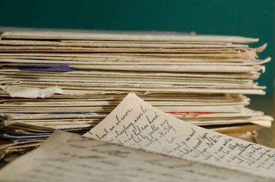 hand written letters in a stack nice cursive