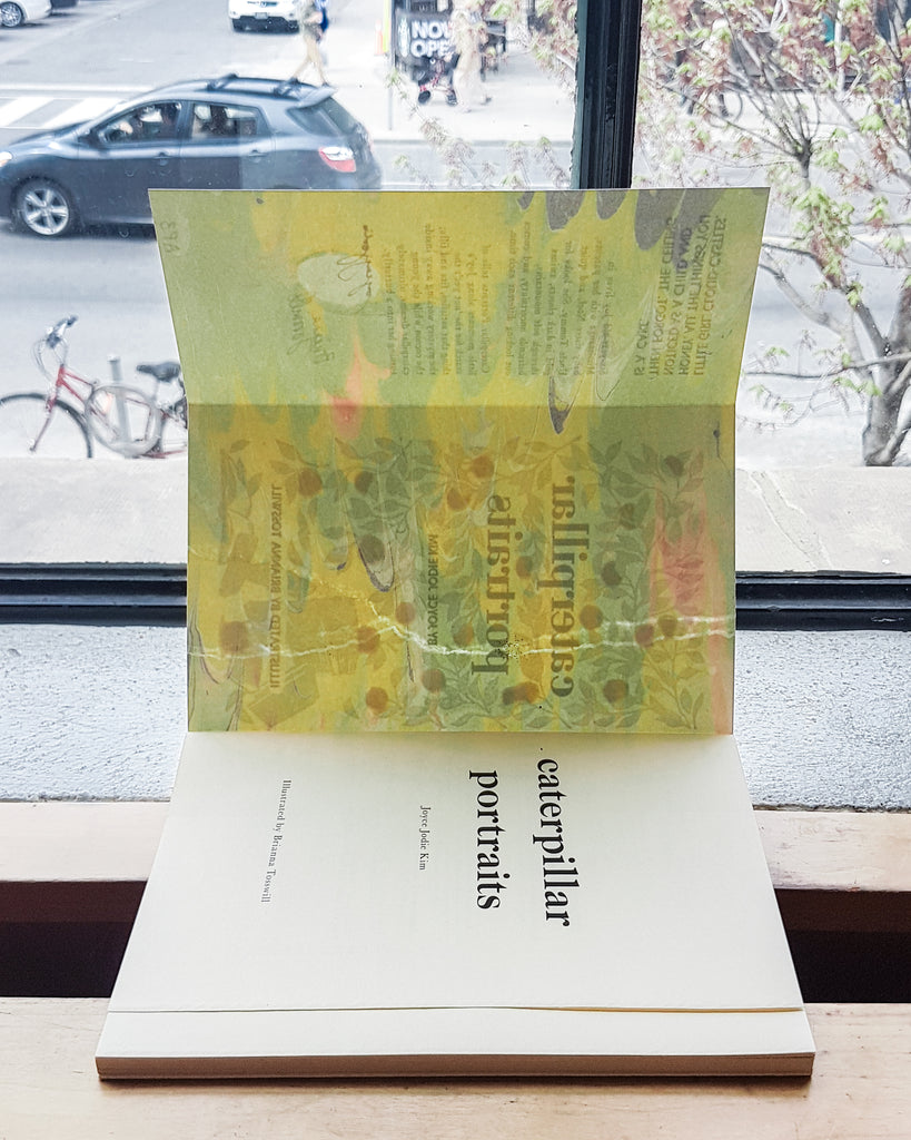 Caterpillar Portraits open in front of a window, so the light streams through the marbling inside the cover and tints it yellow.