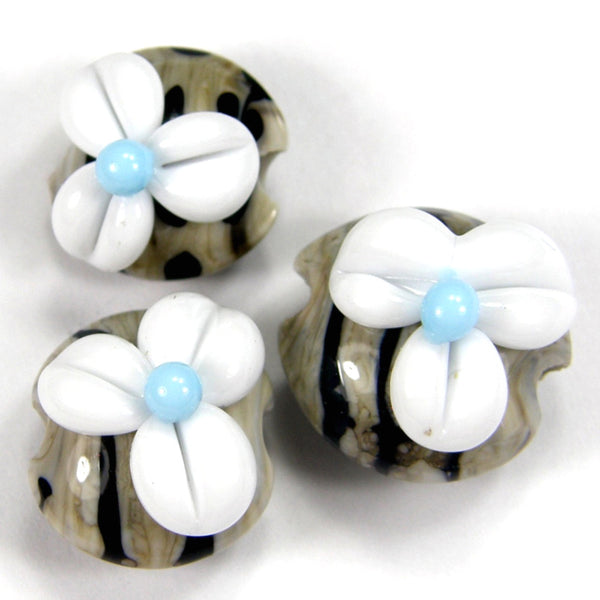 Fossil Ivory and Navy Striped Handmade Lampwork Lentil Beads With Raised White Flowers On Top
