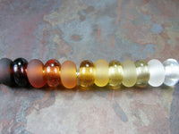 Example group of shiny and etched amber and clear large hole lampwork beads