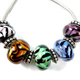 Example group of zebra and tiger stripe large hole lampwork beads in different colors