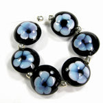 Handmade Lampwork Glass Lentil Bead Set, Black Blue Flowers Shiny