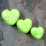 Example showing different sizes of handmade lampwork heart beads