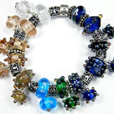 Example showing different colors and variety of shapes of handmade large hole lampwork beads