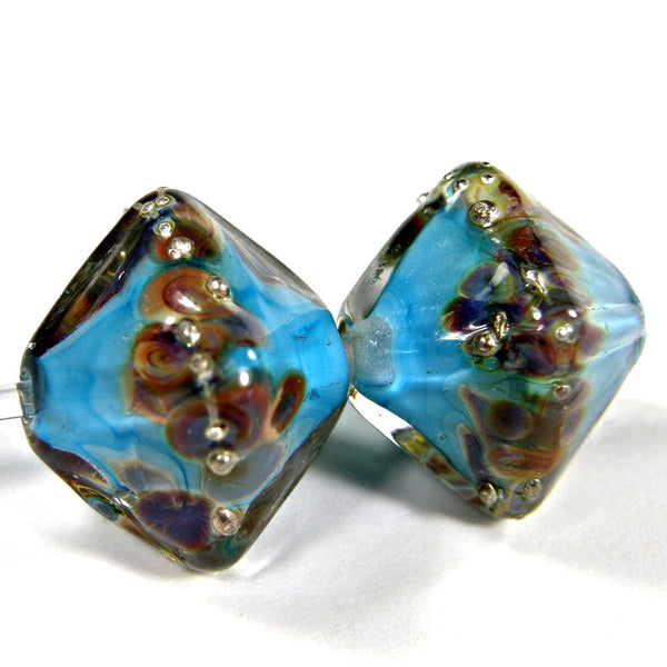 https://covergirlbeads.com/collections/handmade-lampwork-diamond-glass-beads/products/handmade-lampwork-glass-diamond-beads-dk-sky-blue-raku-silver-encased