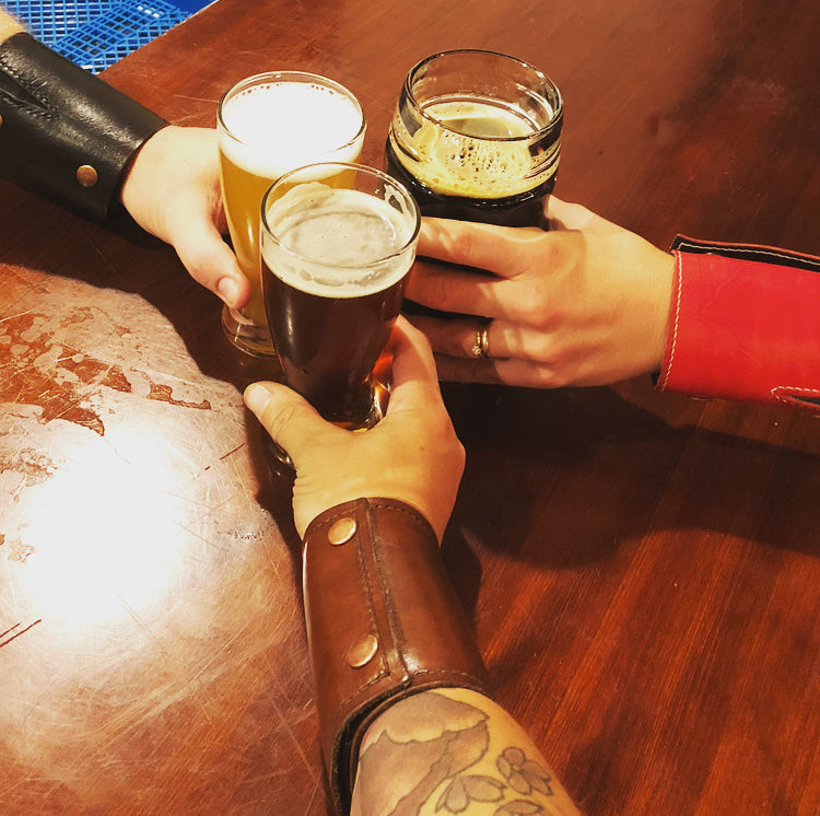 Friends drinking beer together at a brewery with The Wearable Wallet